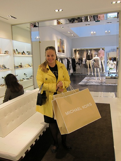 rich girl in michael kors shop in paris
