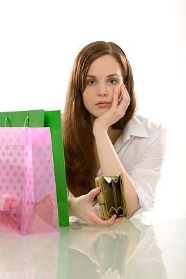 Girl is unhappy with her empty purse