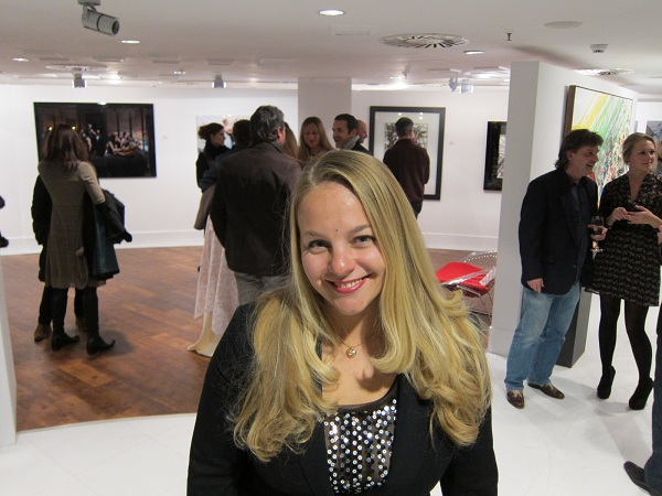 rich girl attends red penguin art gallery in marbella