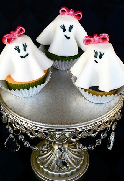 cute halloween cupcakes in shape of girls ghosts with bowties