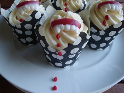 halloween cupcake with vampire teeth and blood drops