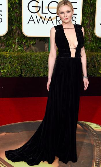 Kirsten Dunst in black Valentino Couture dress at Golden Globes 2016 red carpet