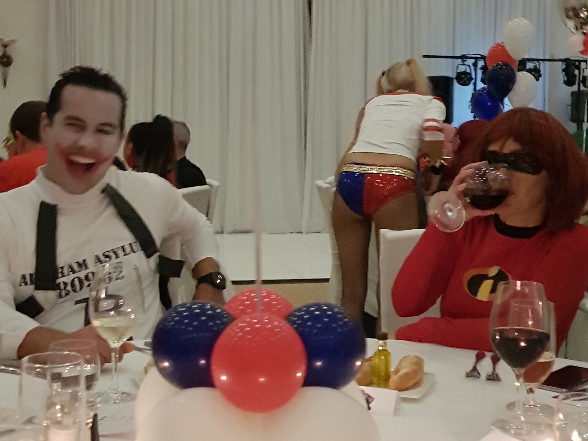 cosplay party with guests dressed as Harley Quinn and Joker