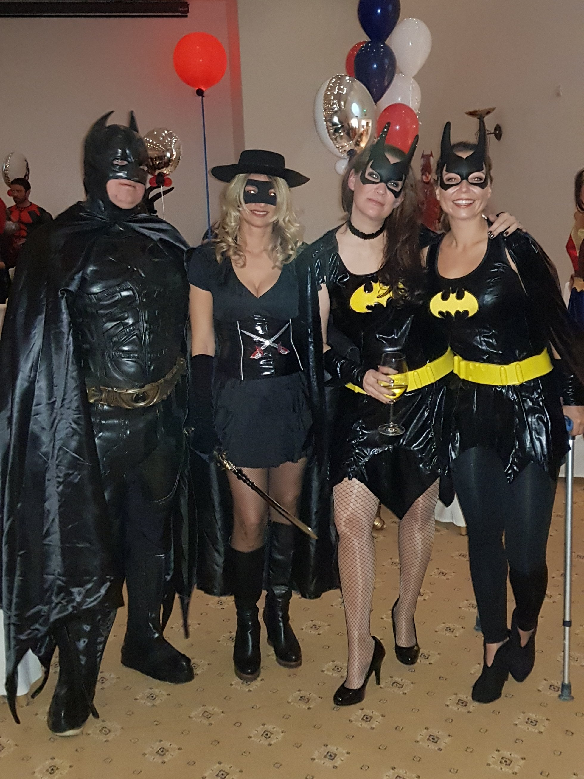 Birthday party guests dressed as Batman and batwoman