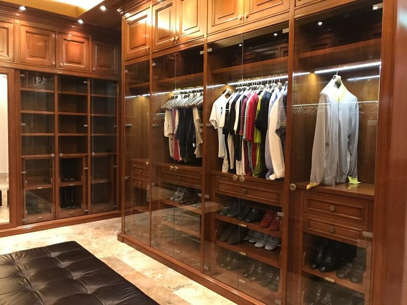 Luxurious brown wood elegant walk in closet